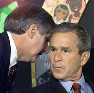 (FILES): This 11 September 2001 file photo from an early morning school reading event Sarasota, Florida, shows White house Chief of Staff Andrew Card (L) informing US President George W. Bush (R) of the attacks on the World Trade Center in New York. A bipartisan US commission pins the blame for the 11 September 2001 terror attacks on a broad array of lapses by federal and local law enforcement officials and intelligence agencies, in its final report to be released 22 July 2004. AFP PHOTO/FILES/Paul J. RICHARDS (Photo credit should read PAUL J. RICHARDS/AFP/Getty Images)